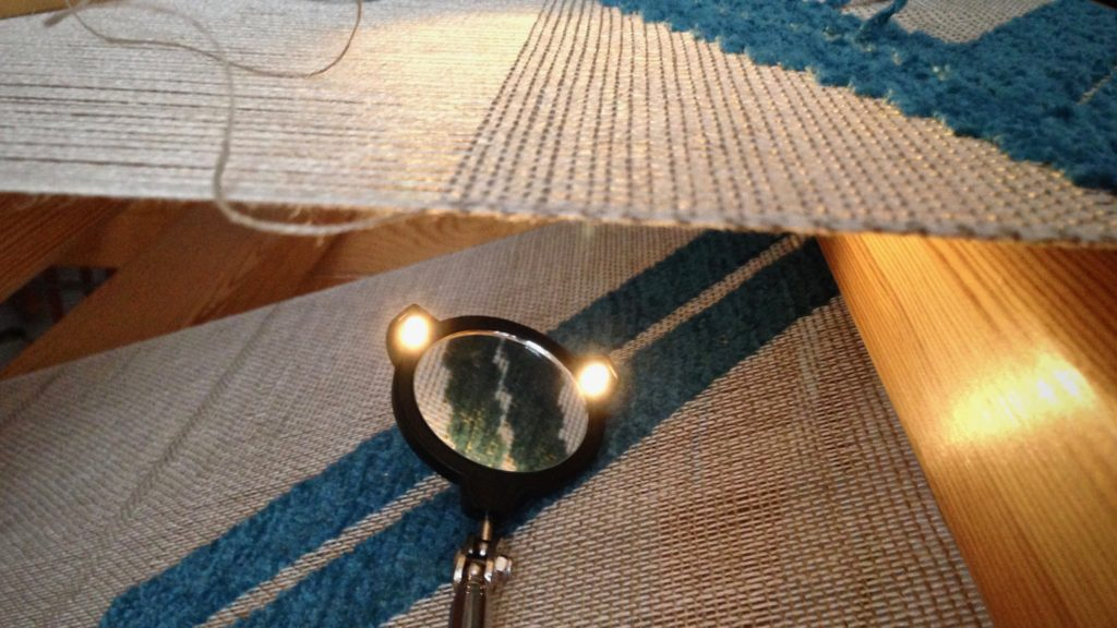 Lighted mirror extends to inspect underneath the cloth.