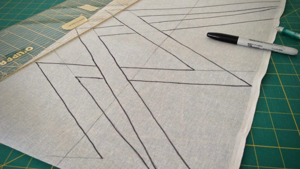 Drawing a cartoon on buckram for weaving a transparency.