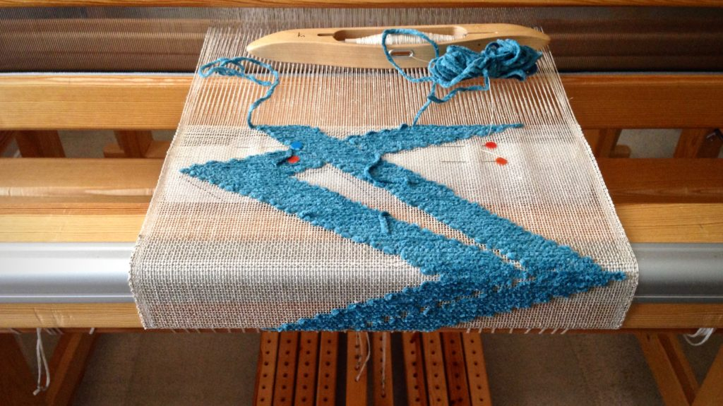 Transparency weaving on the loom, with buckram cartoon.