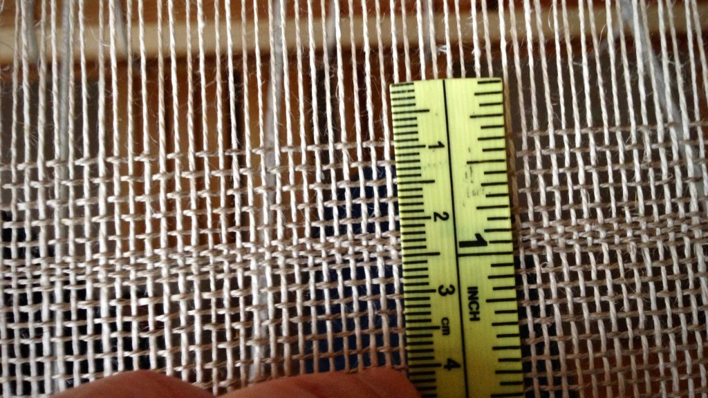 Trying to weave linen at 5 picks per centimeter.