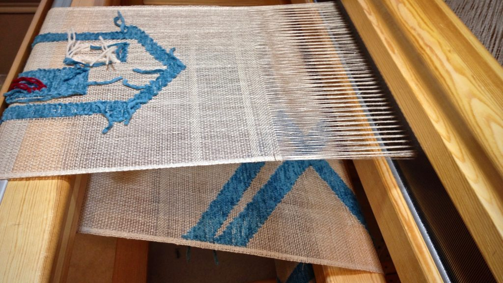 Transparency weaving. Linen warp and weft. Cotton chenille pattern weft.