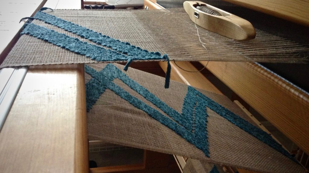 Weaving a transparency. Linen warp and weft. Cotton chenille pattern weft.