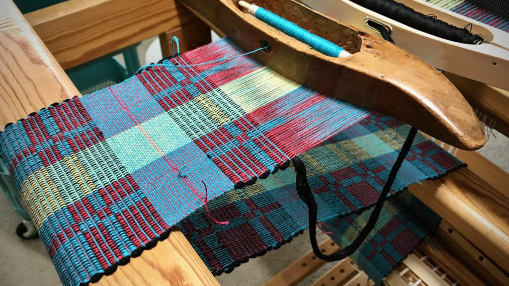 Rep weave mug rugs on the loom.