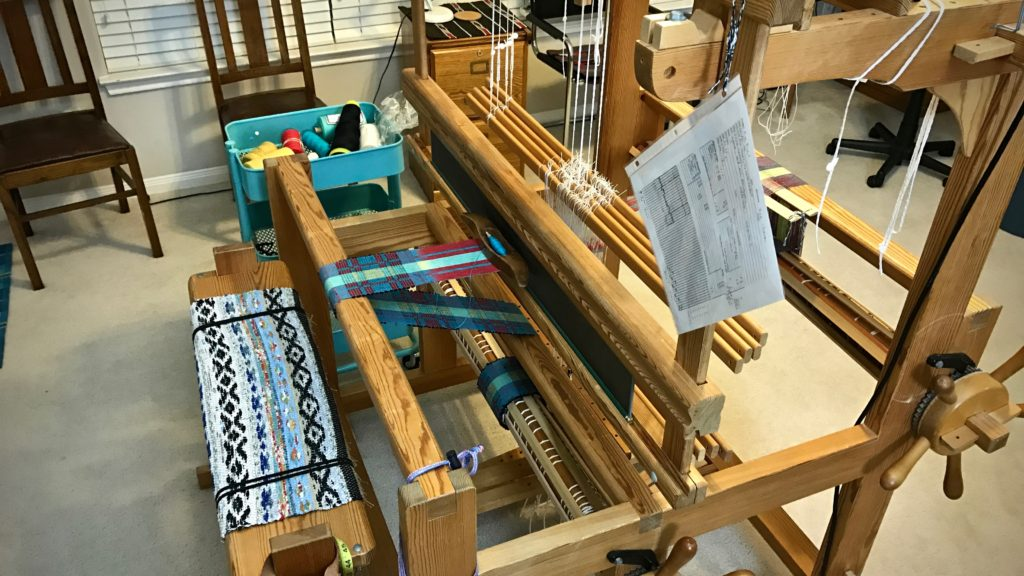 Weaving draft in place for weaving mug rugs.