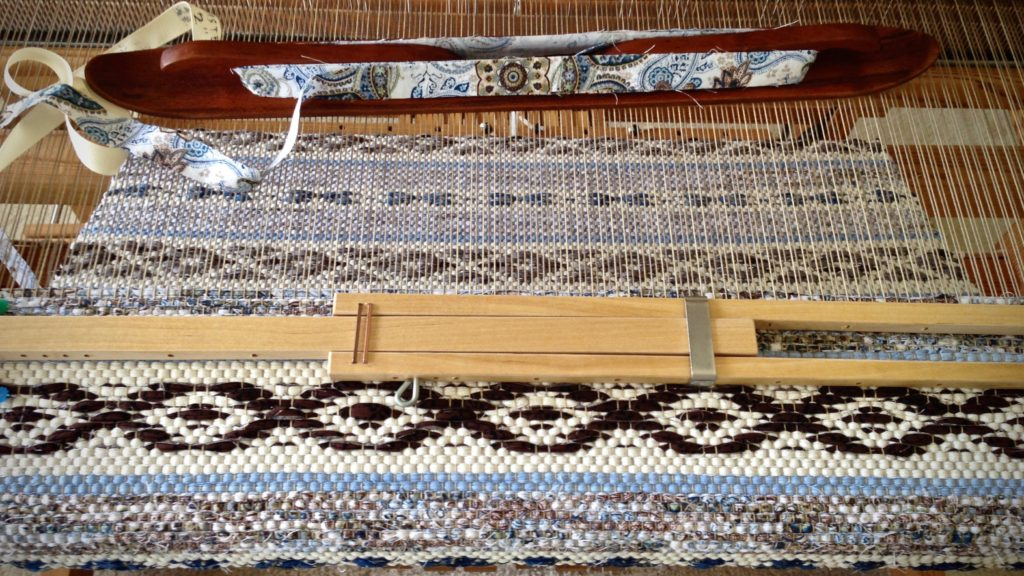 Temple in place, weaving Swedish rosepath rag rug.