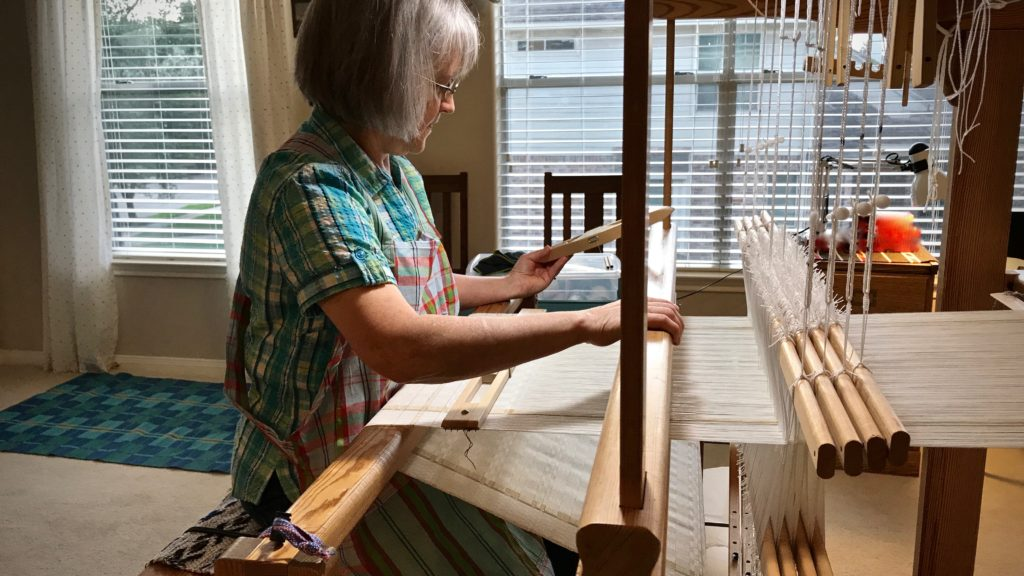 Sister comes to visit and gets her first weaving lesson.