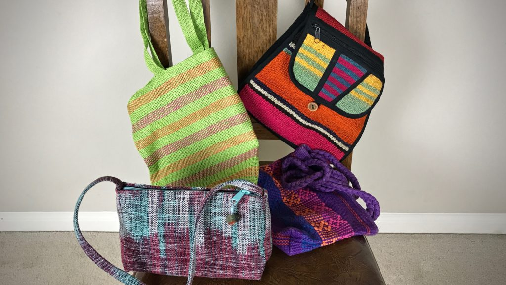 Handwoven handbags from international travels.