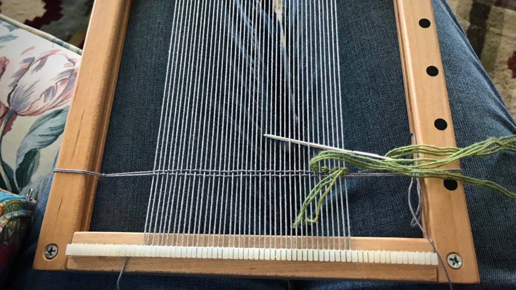 Travel tapestry loom is warped before hitting the road.