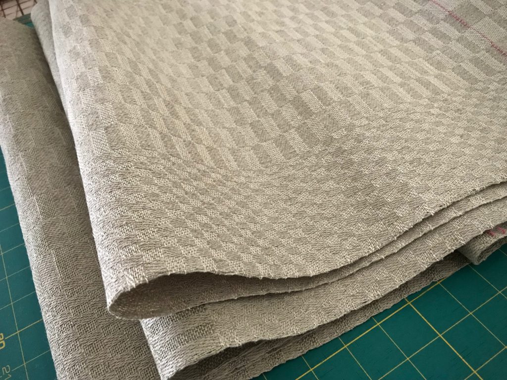 Linen fabric just off the loom, ready for finishing.