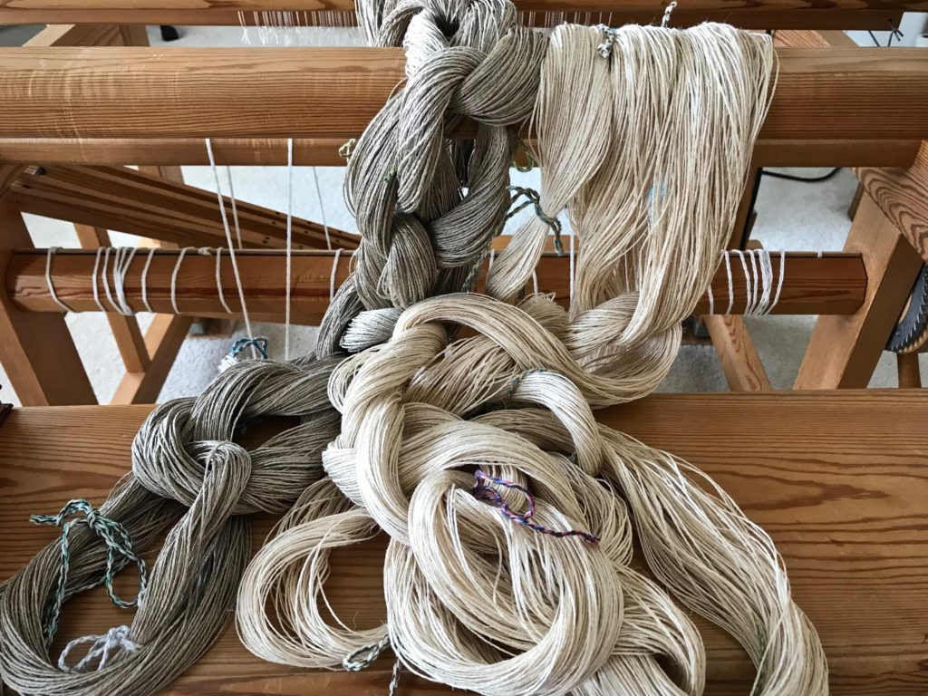 Two linen warp chains, ready for dressing the loom.