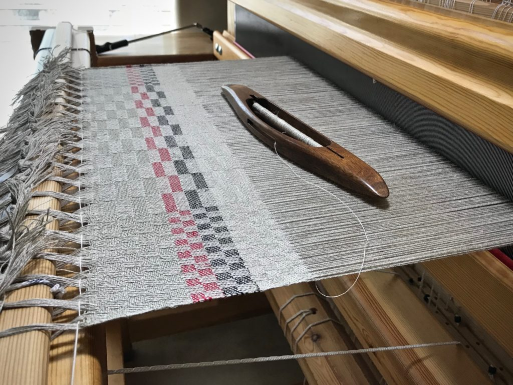 Sampling weft colors on a linen warp.