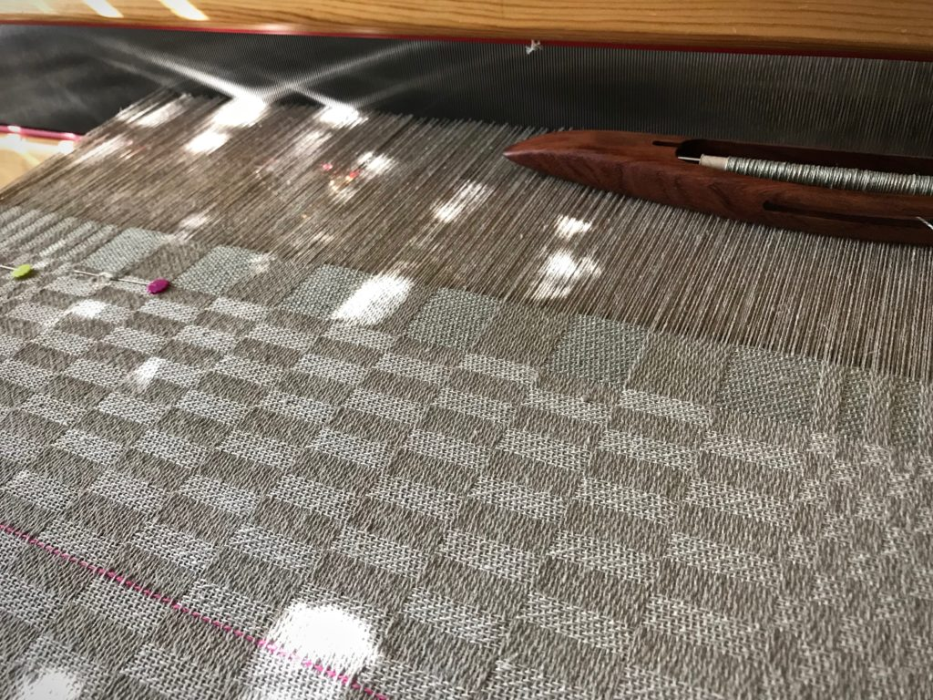 Sunlit linen damask weaving.