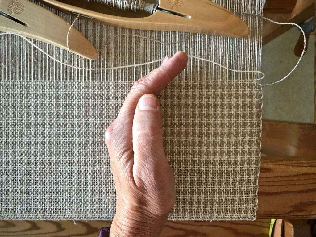 Shadow reveals the pattern in this linen color and weave.