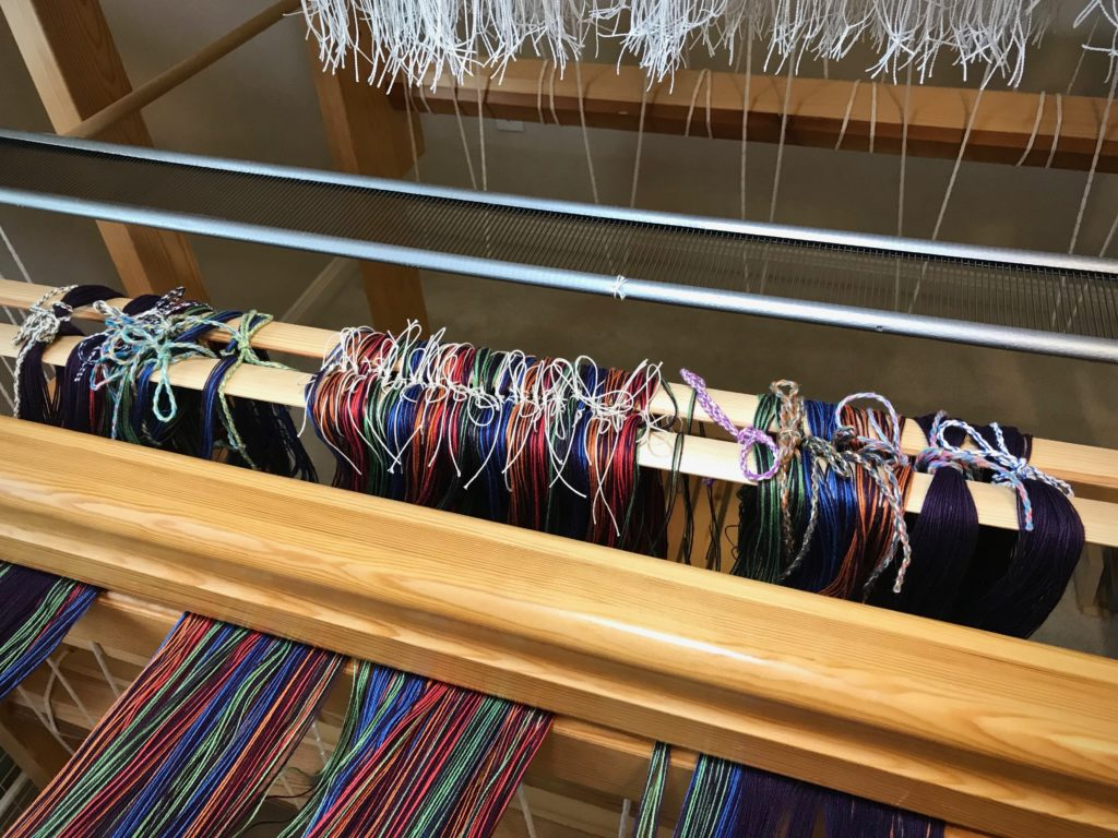 Delicate transfer of warp ends accomplished!