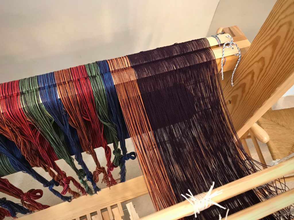 Threading heddles, from right to left.