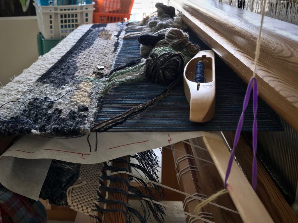 Four-shaft tapestry in progress on the loom.
