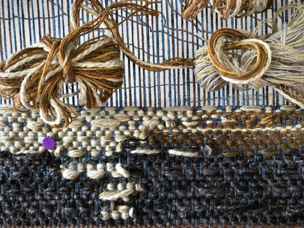 Blending yarn colors and thicknesses for tapestry.