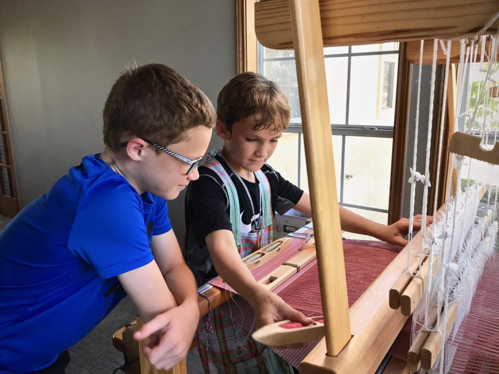 Young weavers at the loom.