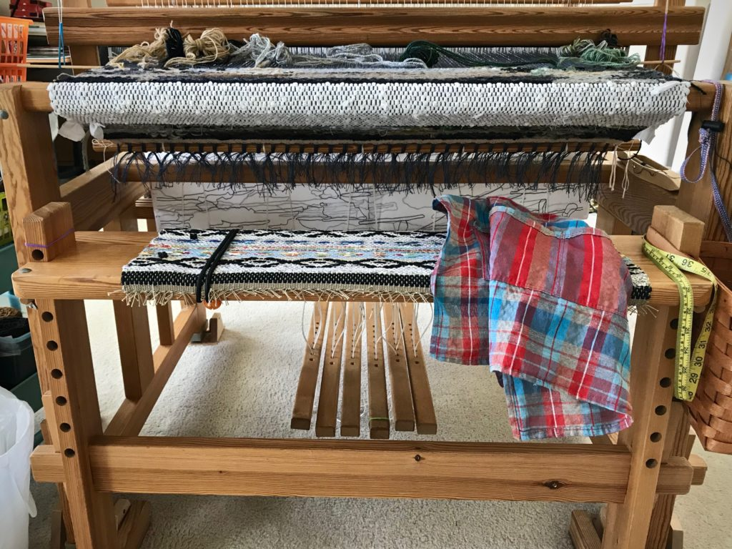 Weaving apron is used to protect fabric on the loom and on the weaver.