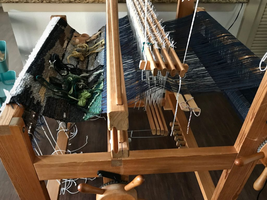 Re-assembling loom after relocating.