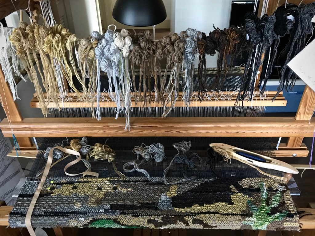 Weaving four-shaft tapestry on a Glimakra Ideal loom.