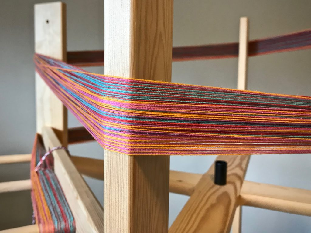 Winding a warp for double weave towels.