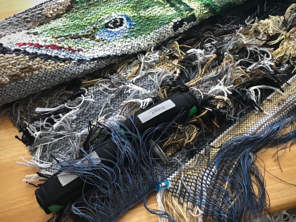 Finishing the ends on the Lizard tapestry.