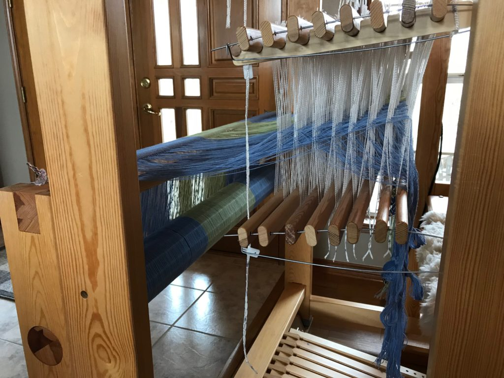 Threading is complete. 8-shafts undulating twill.