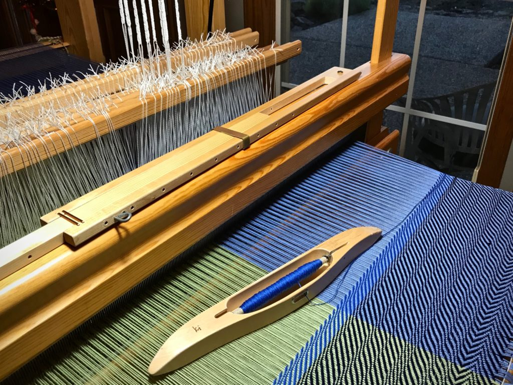 Testing weft colors for undulating twill cotton throw.