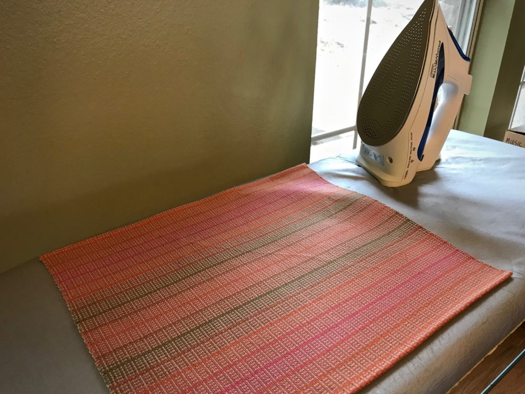 Pressing handwoven placemats.