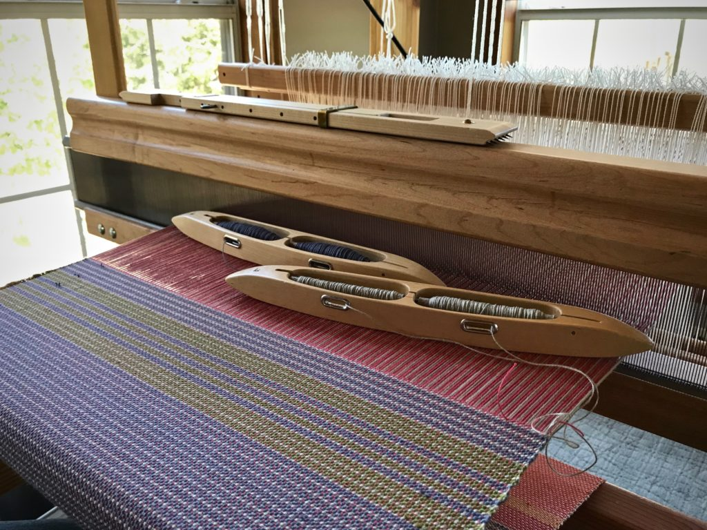 Weaving placemats in a sunny corner.