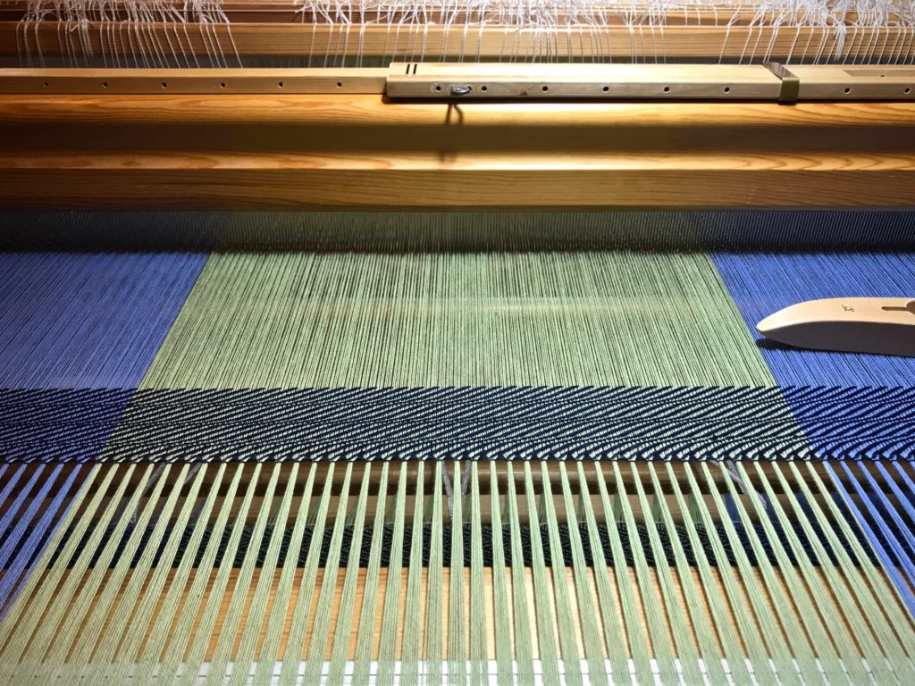 Hemstitching at the beginning of the cotton throw.