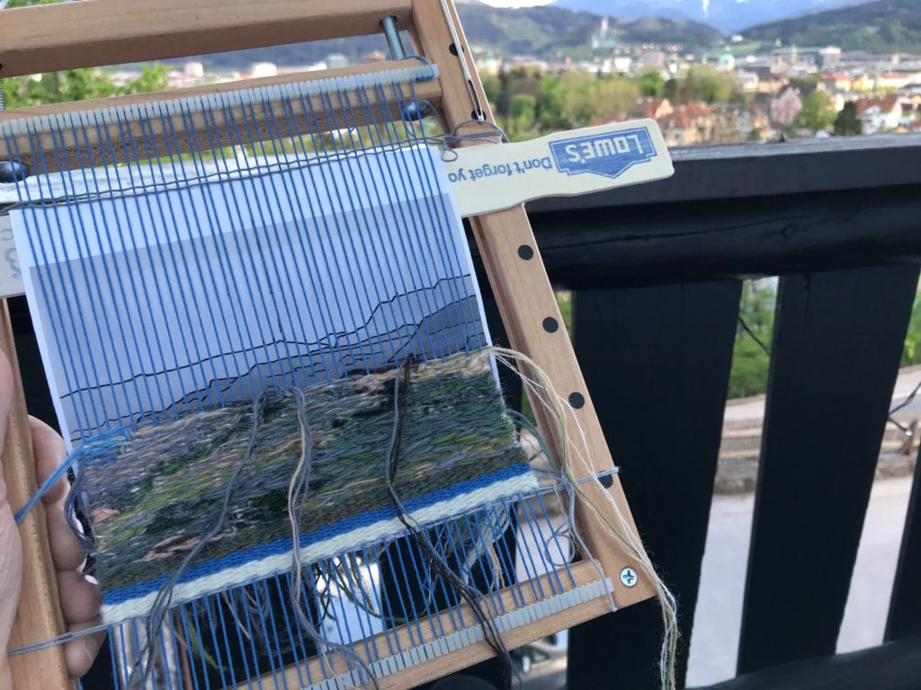 Weaving an image from Big Bend State Park, Texas, while enjoying the balcony view in Innsbruck, Austria.