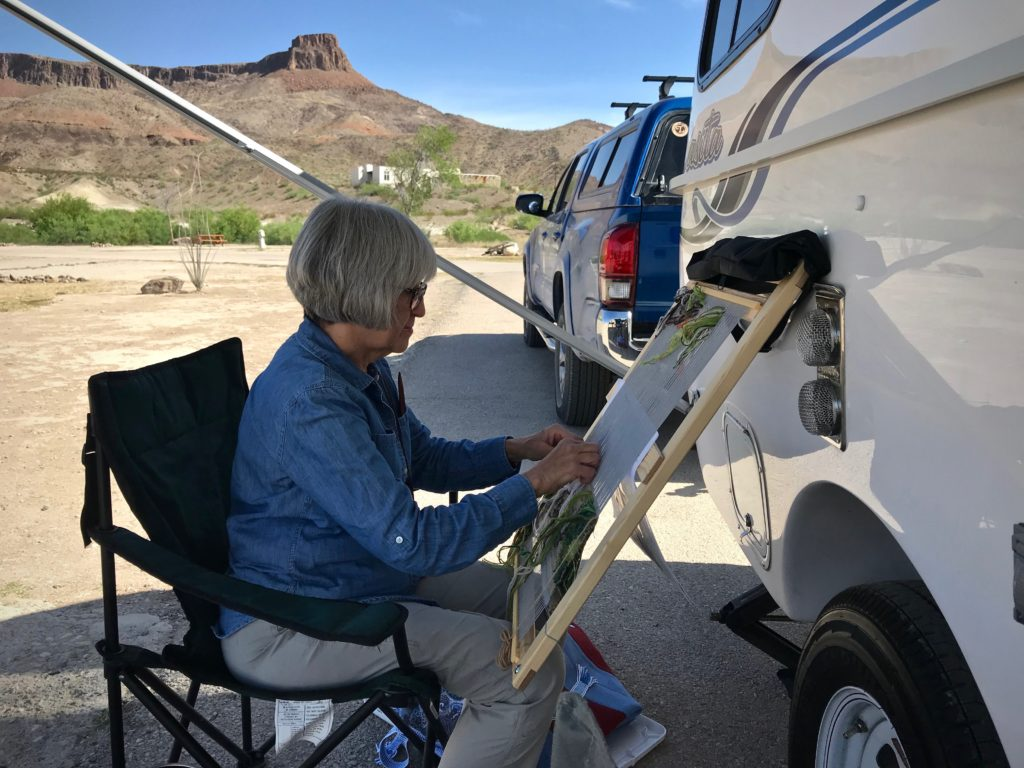 En plein air tapestry weaving by the Casita travel trailer.