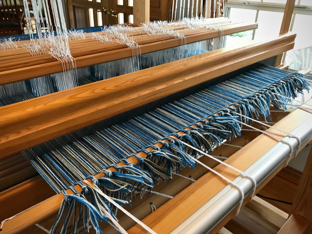 Wool warp for a double weave blanket.