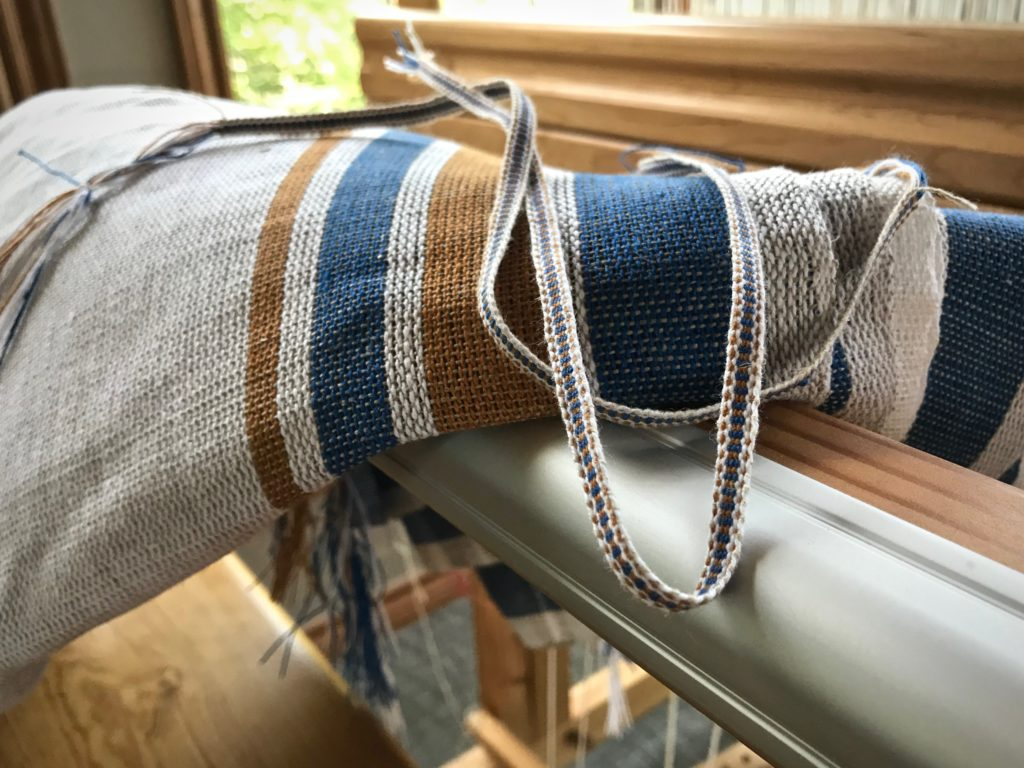 Using thrums to make coordinating tabs for handwoven towels.