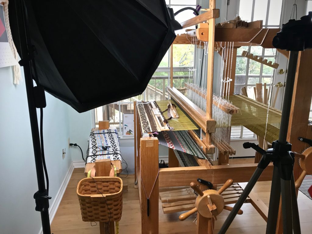 Filming a short video on weaving rag rug selvedges.