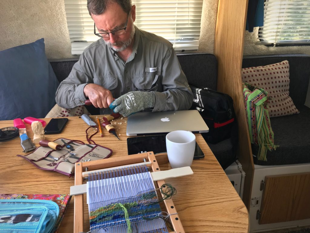 Relaxing in the Casita travel trailer. Wood carving and tapestry weaving.