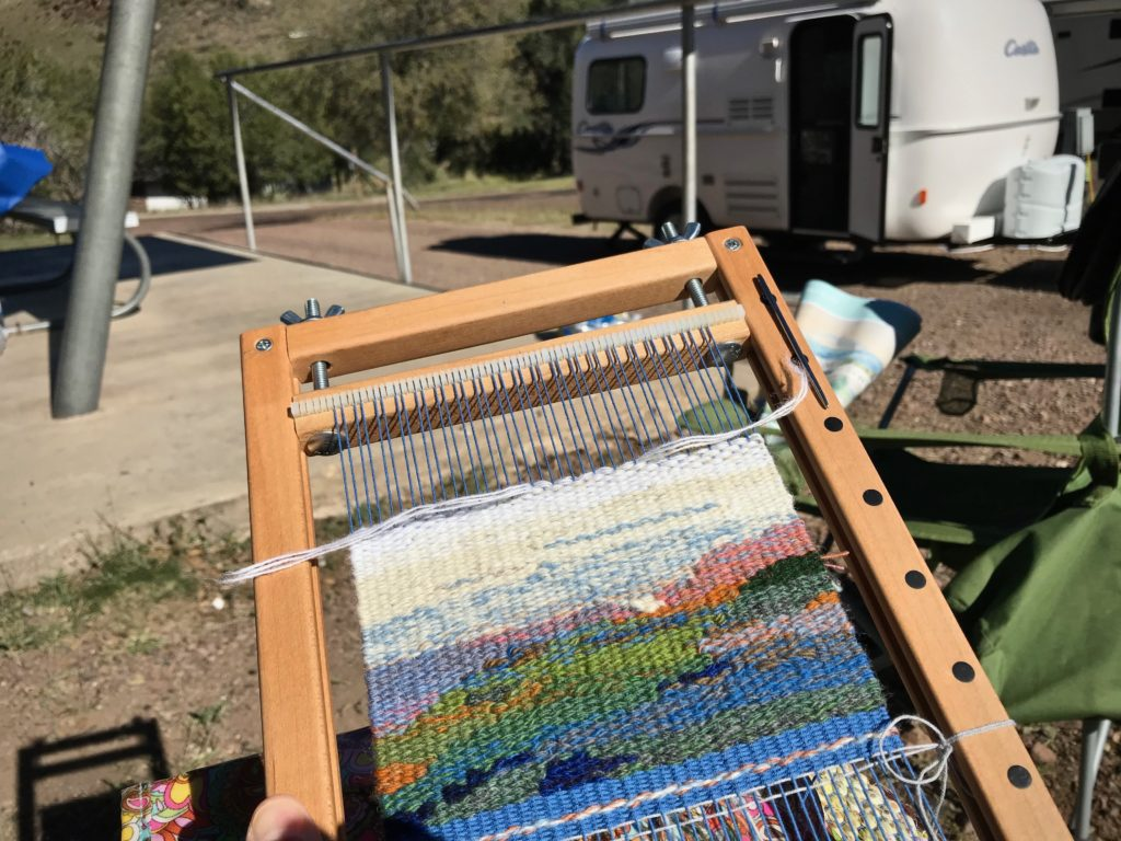 Weaving in the sunshine on a camping trip.