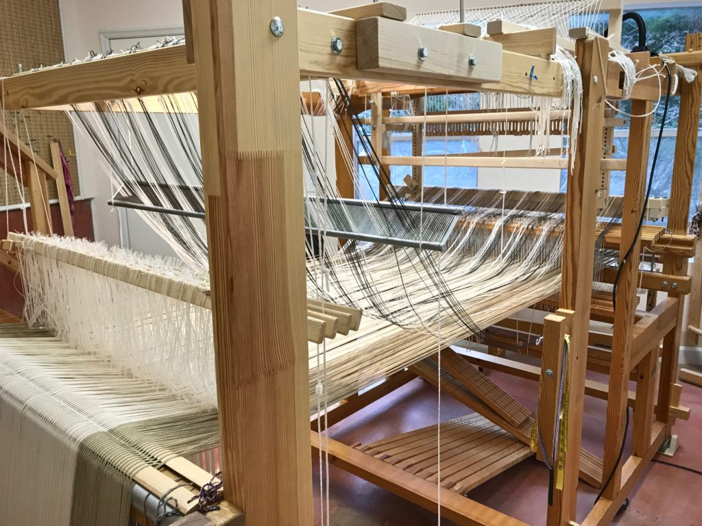 Setting up single-unit draw cords on the drawloom.