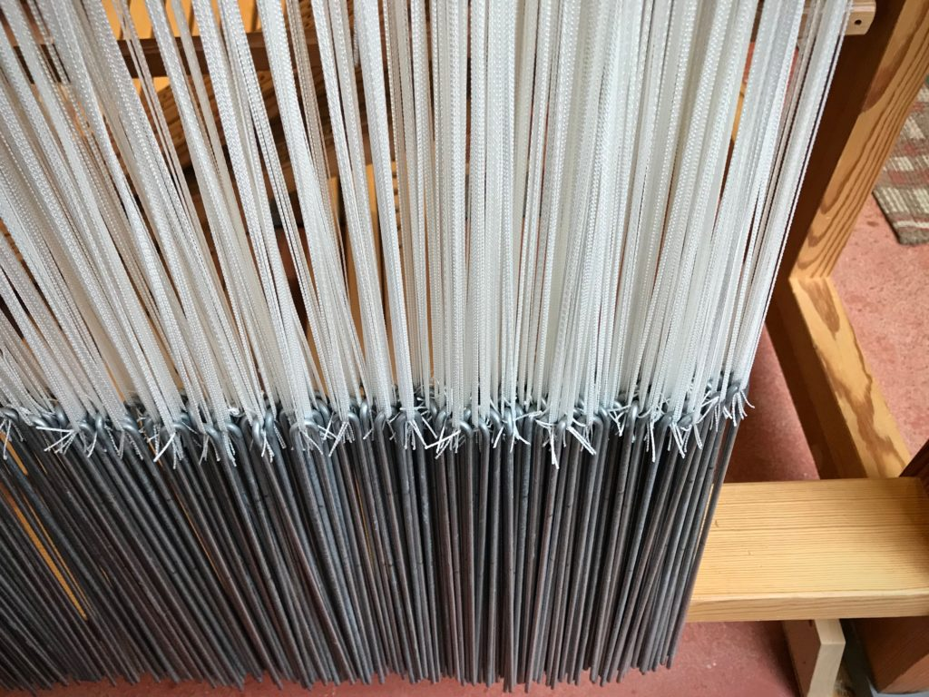 Pattern heddles and weights for prepping the drawloom.